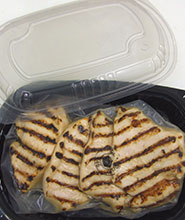 Tray packed, lower sodium flame broiled chicken breasts.
